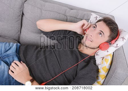 Man Listening Music On Couch.