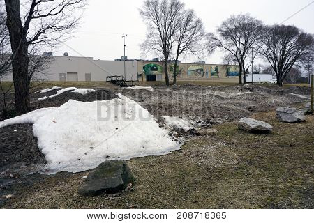 BAY VIEW, MICHIGAN / UNITED STATES - MARCH 30, 2017: Piles of snow melt near the Tannery Creek Trailhead during March.