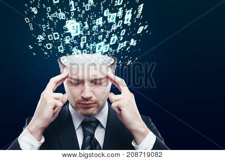 Abstract image of pensive young businessman with abstract binary code stream on blue background. Programming concept
