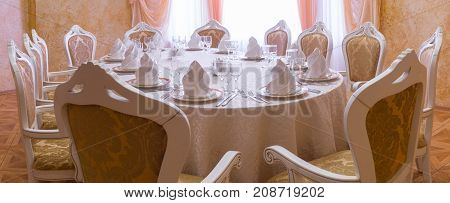 restaurant white hall with wedding table and pure glass