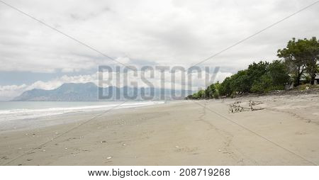 Empty White Sand Beach With Pebbles And Clear Blue Ocean Waves At Bajawa Ruting Flores In The Mornin