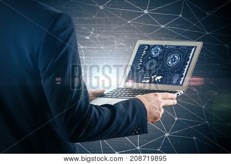 Side view of businessman using laptop with business chart. Polygonal mesh background. Finance concept. Double exposure