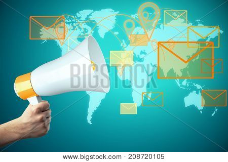 Hand holding megaphone on abstract blue background with map and letter icons. E-mail network concept. 3D Rendering