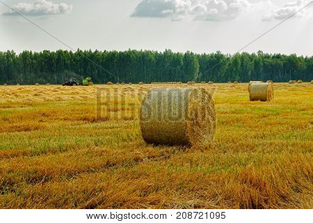 Hay Bales With Tractor Background