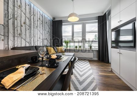 Modern interior design small living room and wooden dinning table