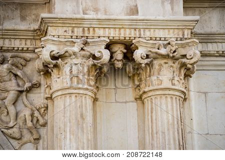 corinthian capital, Details of stone sculptures of the facade of the University of Alcalá de Henares. Madrid, Spain