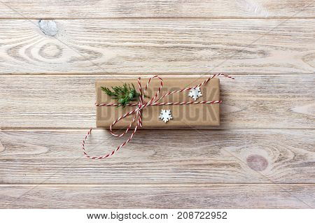 gift box wrapped in recycled paper with ribbon bow with ribbon rustic.