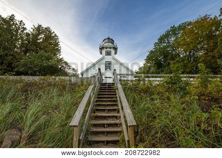 Old Mission Point Lighthouse In Michigan. The Old Mission Point lighthouse is a popular landmark in Michigan. The lighthouse is located in a county park and not a privately owned property or residence