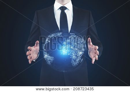 Businessman holding abstract glowing globe on dark background. Global business concept. 3D Rendering