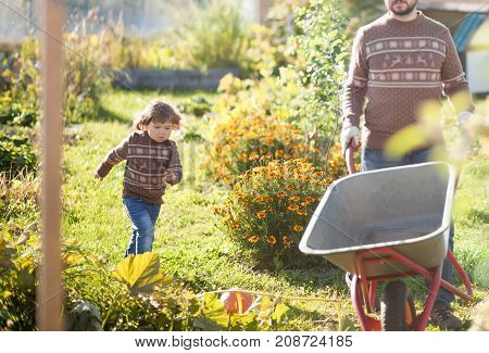 Father And Child Working In The Garden