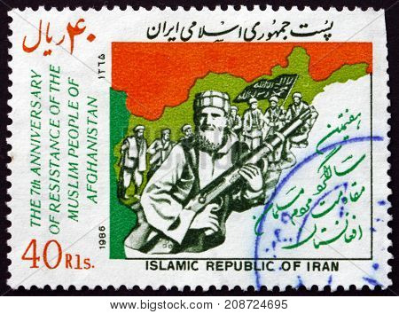 IRAN - CIRCA 1986: a stamp printed in the Iran dedicated to Afghan Resistance Movement 7th Anniversary circa 1986