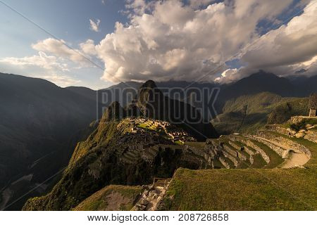 Machu Picchu Illuminated By The Warm Sunset Light. Wide Angle View From The Terraces Above With Scen