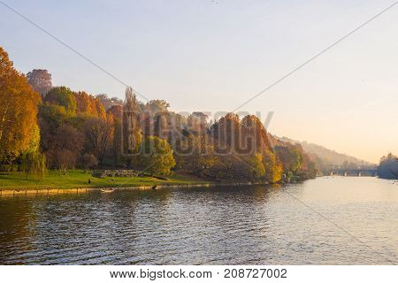 City View Of Torino (turin - Italy) At Sunset In Autumn Season With Church On Hilltop Overlooking Po