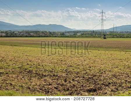 Farming land crop landscape late summer Mountains in distant view