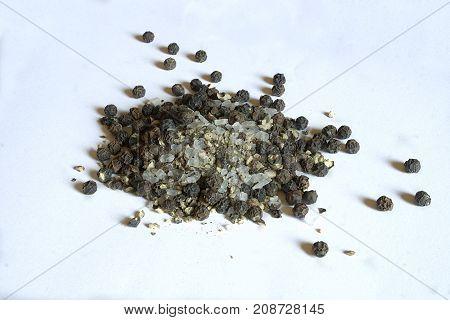 Salt and peppar. Salt and peppar on White background, isolated. Big salt chunks and big black peppar pieces