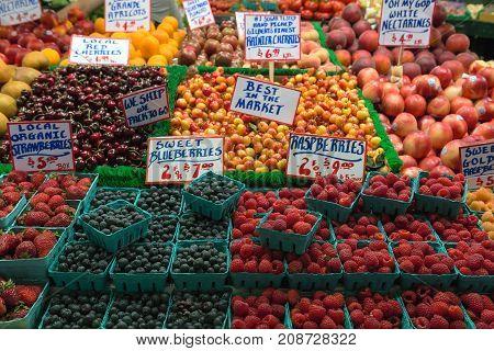Fresh fruits Nectarines Cherry Strawberry Blueberry Rashberry Apricot in public market fruit stall