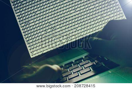 Computer internet hacker binary code on laptop screen