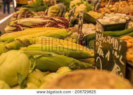 Farmers market various salads  corn in focus