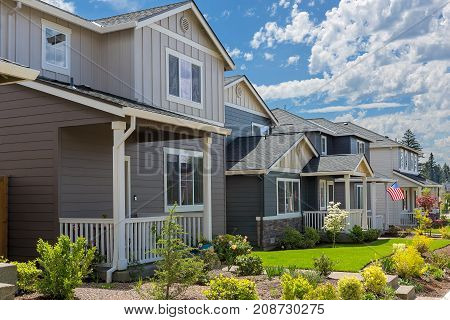 Tract homes with American Flag in new subdivision in North America suburban residential neighborhood poster