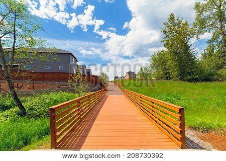 Wood Bridge along hiking trail in neighborhood park in Happy Valley Oregon