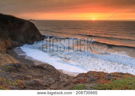 Smoky Sky Sunset of Northern California Coastline, after Napa Fire. Mori Point, San Mateo County, California, USA.