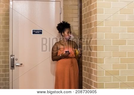 Washington Dc, Usa - August 4, 2017: One African American Young Woman Vaping Smoking Electronic Ciga