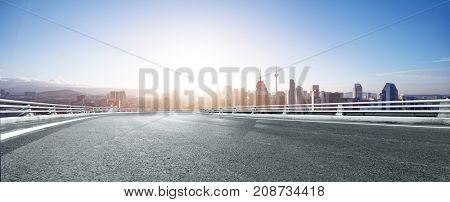 empty asphalt road with cityscape of kuala lumpur with sunbeam