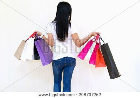 Female walks hands holding shopping bags and credit card