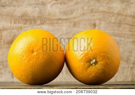 Fresh Navel orange fruit on wooden background