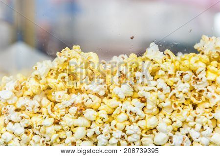 Macro Closeup Of Yellow Popcorn Pattern With Butter Or Oil In Machine Behind Glass