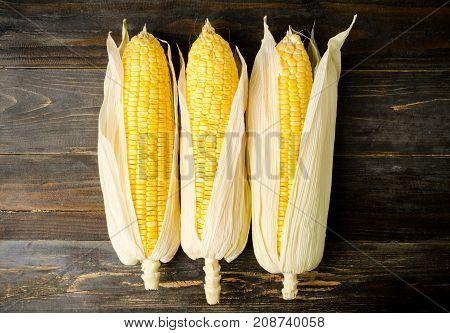 Sweet corn on wooden background, food ingredient