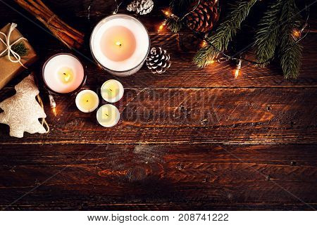Christmas candle and rustic decoration on wood table with christmas lights in night party. copy space flat lay top view. vintage color style.