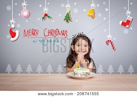children make a wish at new year party with cake and candle