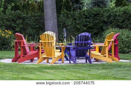 Colored country comfort chairs around big tree