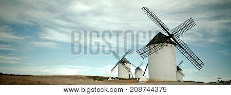 Old Spanish windmills Campo de Criptana Castilla la Mancha province Spain. Toned and vignetted Long wide banner