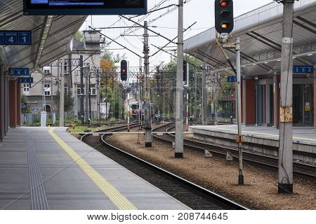 Cracow Poland - October 13 2017: An empty train station platforms the train is waiting for entry to Central Train Station in Cracow Poland.