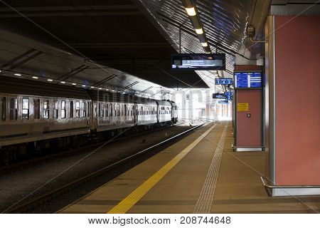 Central train station Cracow Poland - October 13 2017: Empty platform on train station the train waiting for passengers in central train station in Cracow Poland.