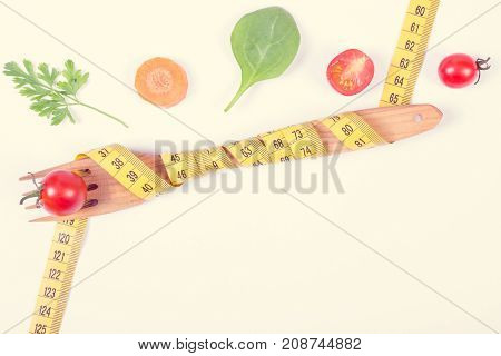 Vintage Photo, Wooden Fork With Centimeter And Vegetables On White Background, Slimming And Healthy