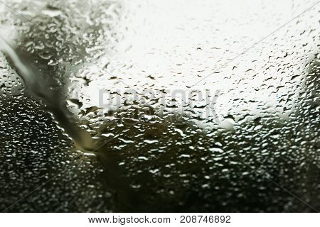 drops of autumn rain on the windshield of the car.