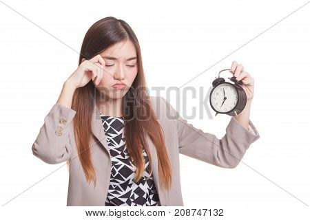Sleepy Young Asian Woman With A Clock In The Morning.
