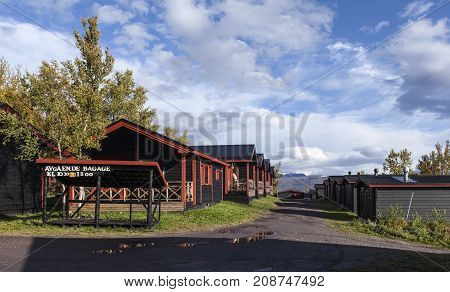 LAPLAND, SWEDEN ON SEPTEMBER 11. Modern, wooden cabin, lodge close to the Hotel Fjallet on September 11, 2017 in Lapland, Sweden. Sunny morning in the autumn, fall. Editorial use.
