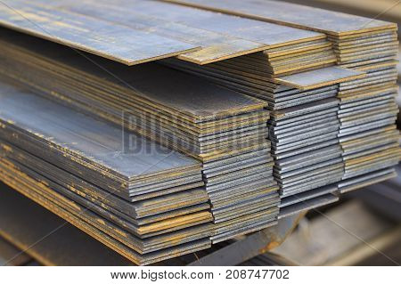 Metal profile strip in packs at the warehouse of metal products Russia