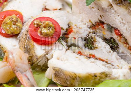 Stuffed fried seabass with tomato on plate