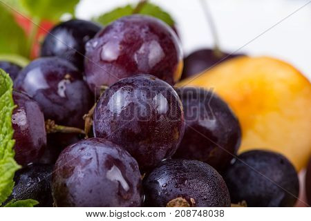 Fruit platter - grapes and peach, closeup photo