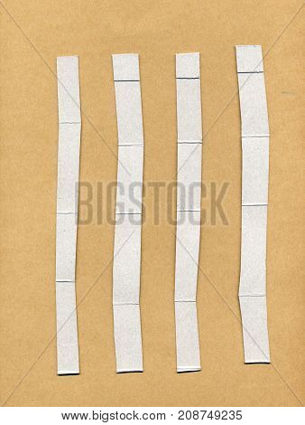 Cardboard Strips Over Brown Paper