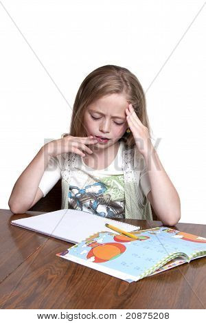 Cute Girl Having A Hard Time With Her Homework