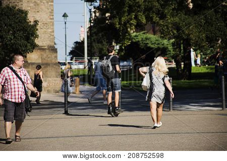 Czechia people walking and use electric unicycling in garden at St. Ludmila at namesti miru or Peace Square on August 29 2017 in Prague Czech Republic