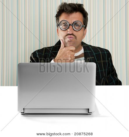 Nerd pensive man glasses silly expression laptop computer thinking a solution