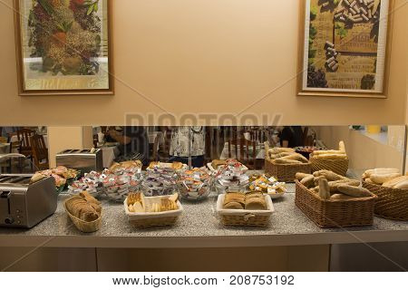 Bread And Loaf In Rattan Wicker Basket For People Eating Breakfast In Restaurant
