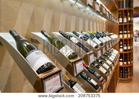 BUSAN, SOUTH KOREA - MAY 28, 2017: bottles on display in Wine Gallery at Lotte Department Store.
